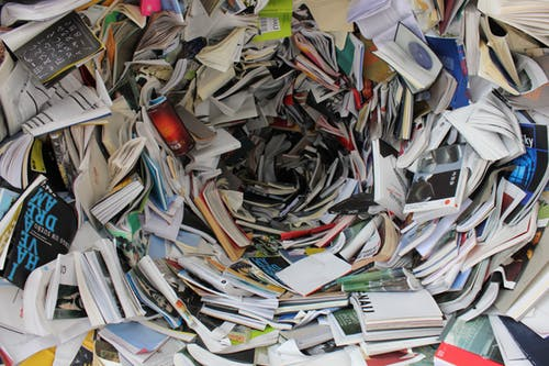A pile of books and papers